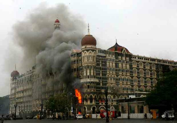 The Taj Mahal Hotel engulfed in smoke during the 2008 attack on Mumbai.