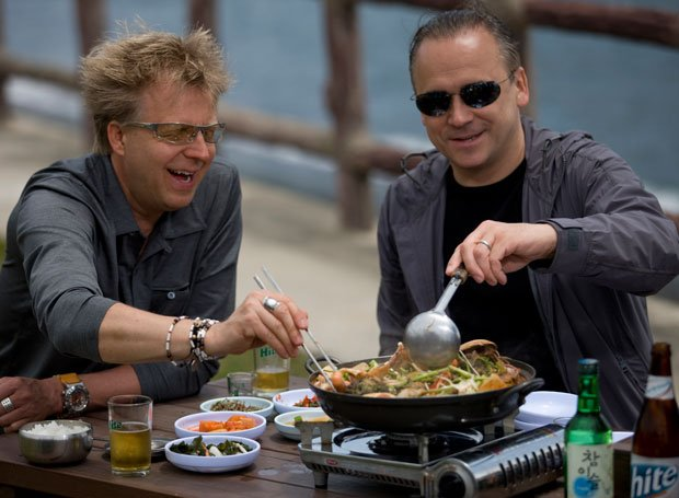 Chef Jean-Georges Vongerichten (right) prepares a delicious, fast stir-fry of...
