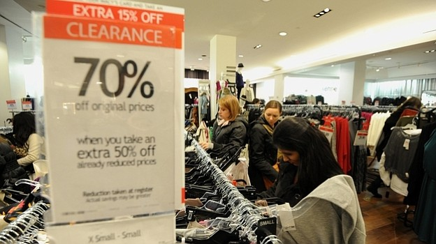 People shop inside Macy's department store in New York after the midnight ope...