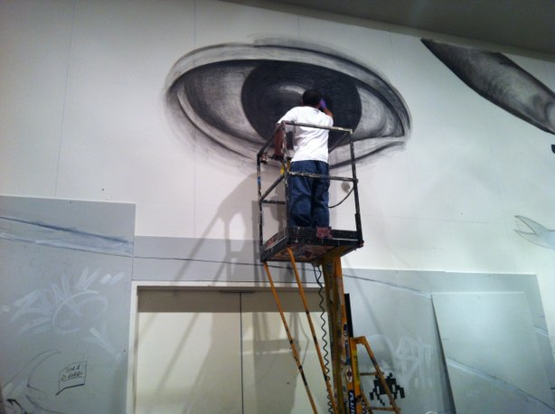 Artist Izze working on a small portion of the 70 foot mural at the San Diego ...