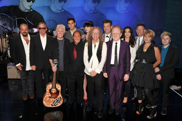 Musicians Raul Malo, Boz Scaggs, Graham Nash, Gabe Saporta, Paul Anka, Victoria Asher, Waddy Wachtel, Chris Isaak, producer Peter Asher, Michelle Branch, Lyle Lovett, Shawn Colvin and Patrick Stump take a cast photo for the concert held at Hollywood's Music Box Theatre in celebration of what would have been Buddy Holly's 75th birthday, September 7, 2011.