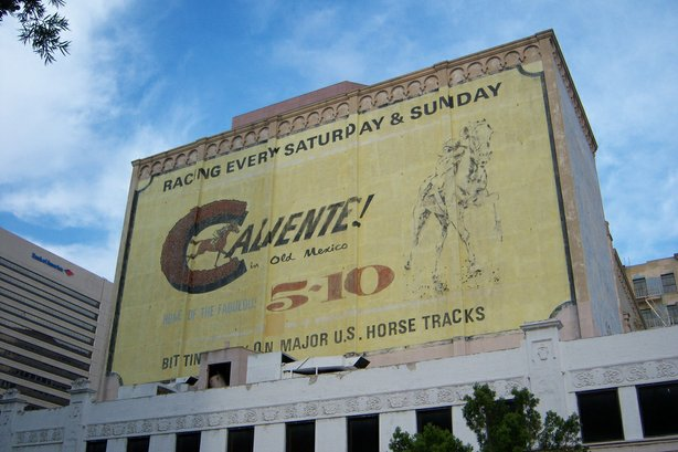 The Caliente advertisement on the side of the historic California Theater dat...