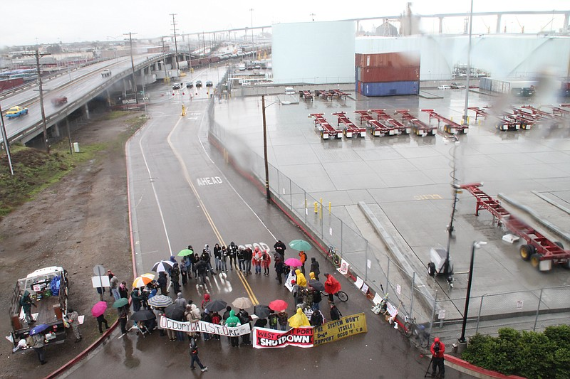 Protesters block an entrance to the San Diego Port on the morning of Monday, ...