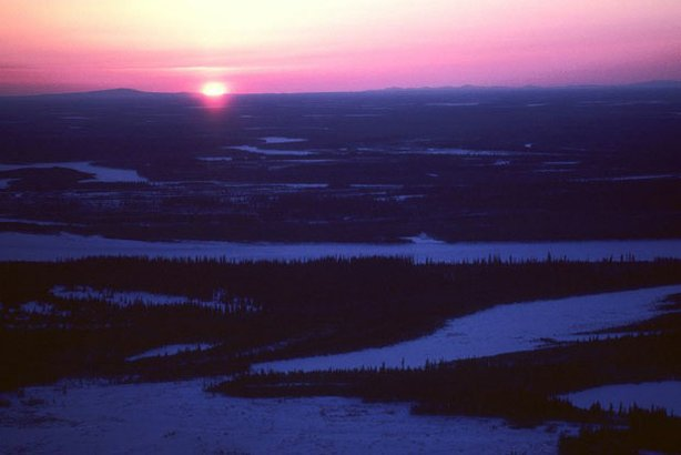 The Arctic National Wildlife Refuge. During November, December, and January, dusky sunlight seeps over the horizon for only a few hours each day in the southern portions of the Refuge. The sun doesn't appear at all farther north.