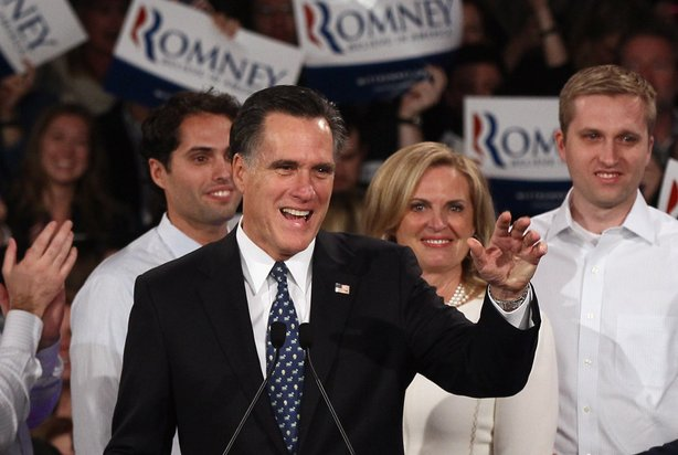 Republican presidential candidate and former Massachusetts Gov. Mitt Romney (C) speaks during his primary night rally with members of his family following the 'first in the nation' primary at Southern New Hampshire University January 10, 2012 in Manchester, New Hampshire.