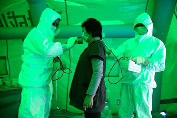 "Image of someone being tested for radiation exposure. FRONTLINE correspondent Miles O'Brien examines the implications of the Fukushima accident for U.S. nuclear safety in ""Nuclear Aftershocks."""