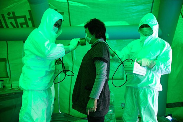 Image of someone being tested for radiation exposure. FRONTLINE correspondent...