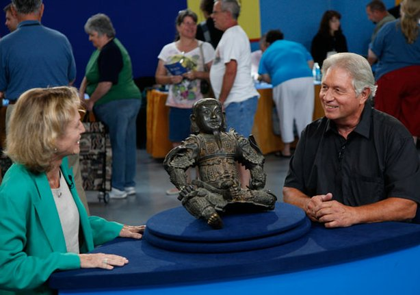 At ANTIQUES ROADSHOW in Tulsa, Oklahoma, appraiser Dessa Goddard admires this circa 1600 Ming Dynasty cast bronze guardian figure. Goddard assigns a value between $70,000-$100,000 to this Chinese figure.