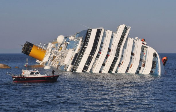 The cruise ship Costa Concordia lies stricken off the shore of the island of ...