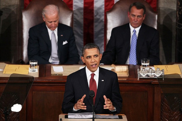 President Obama, flanked by Vice President Biden and Speaker of the House Joh...