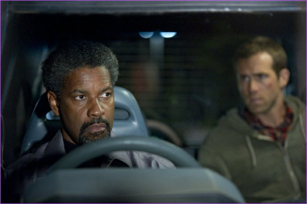 "Denzel Washington and Ryan Reynolds CIA-it-up in ""Safe House""."