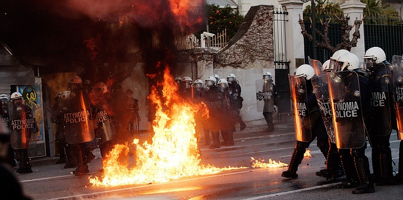 Demonstrators throw fire bombs to riot police during violent protests in cent...
