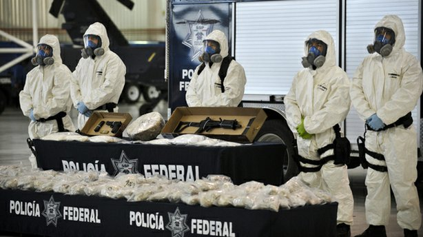 Mexican police show the drug and weapons seized from Jaime Herrera Herrera, a...