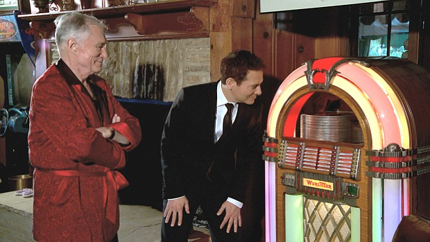 Michael Feinstein (right) inspects a vintage jukebox owned by Hugh Hefner (le...