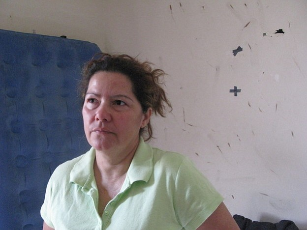 Luz Escamilla's bedroom walls are stained with the blood of bedbugs. She says...