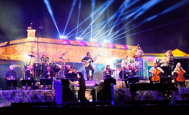 Yanni, backed by his orchestra, performs at the historic 16th-century Castill...