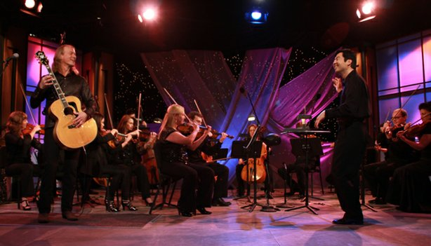 Guitarist and composer Billy McLaughlin performs a concert with Orchestra Nova, conducted by Jung-Ho Pak in the KPBS studio.
