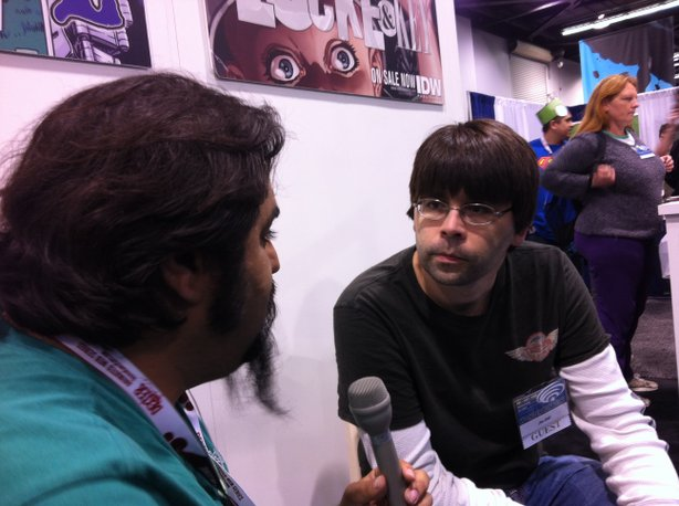 Miguel Rodriguez interviewing Joe Hill at Cryptozoic Entertainment's booth at...