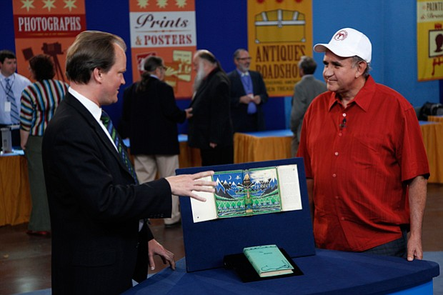 At ANTIQUES ROADSHOW in El Paso, Texas, book expert Ian Ehling (left) has his...