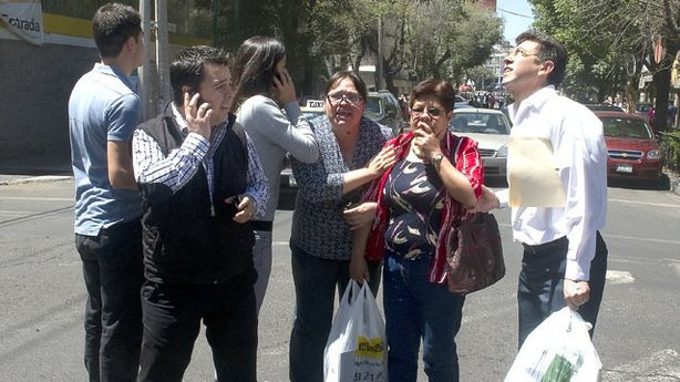 People run to safety on the streets of Mexico City after a quake measuring 7.6 according to US experts, hits Mexico, March 20, 2012.