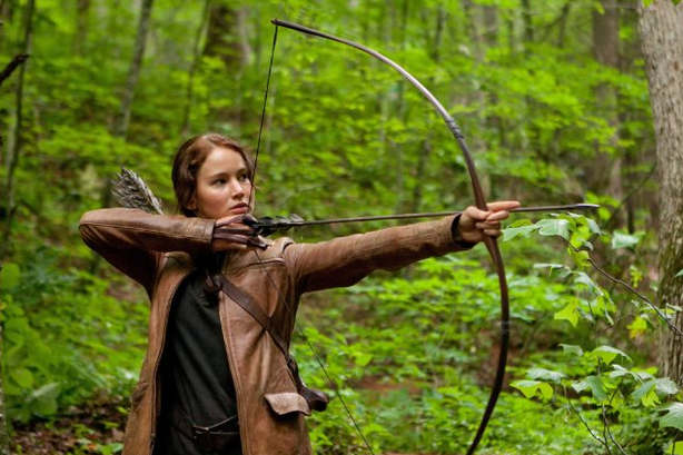 "Jennifer Lawrence stars in ""The Hunger Games,"" which opened at 12:01am on Mar..."