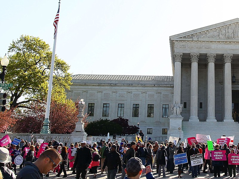 People participate in a protest on the second day of oral arguments for the P...