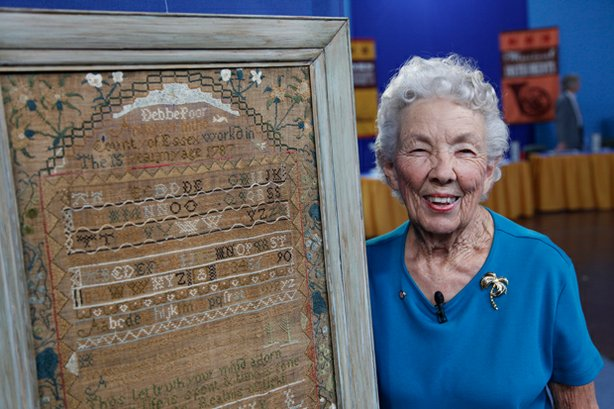 At ANTIQUES ROADSHOW in El Paso, Texas, the proud owner shows off this rare 1787 needlework sampler made by her great, great-grandmother in Andover, Massachusetts and valued at $40,000.