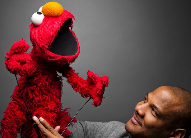"Elmo and Kevin Clash in the documentary ""Being Elmo."""
