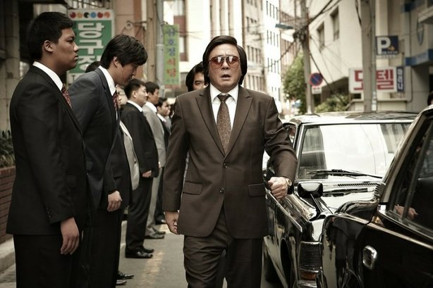 "Choi Min-sik as the civil servant who rises to crime boss in ""Nameless Gangster."""