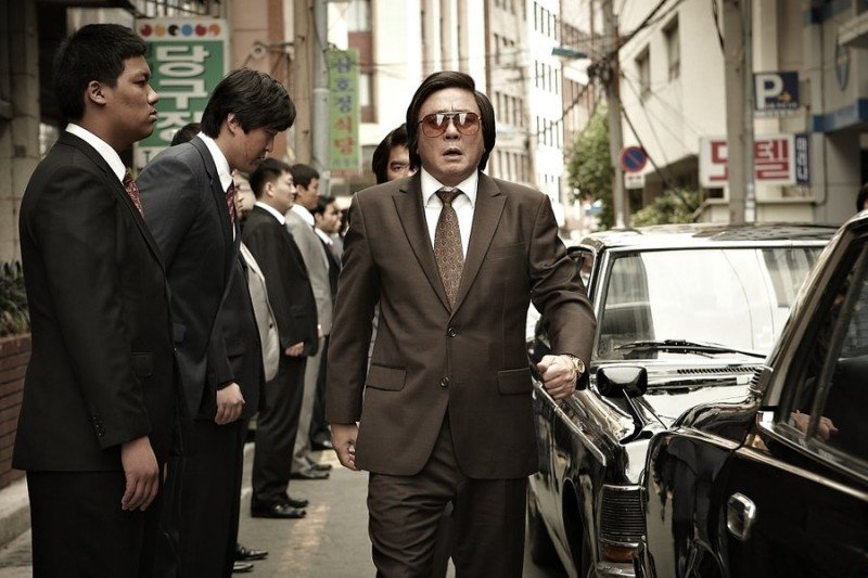 Choi Min-sik as the civil servant who rises to crime boss in
