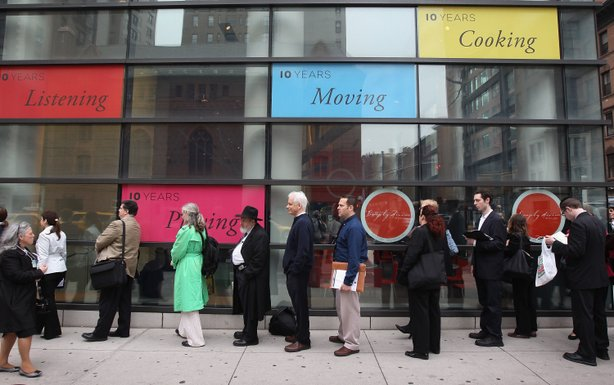 People stand in a line that stretched around the block to enter a job fair held at the Jewish Community Center (JCC), on March 21, 2012 in New York City.