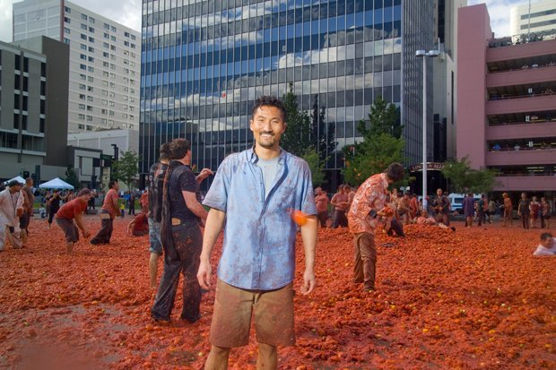 Host Yul Kwon at La Tomatina en Reno, America's biggest tomato fight. Using a...
