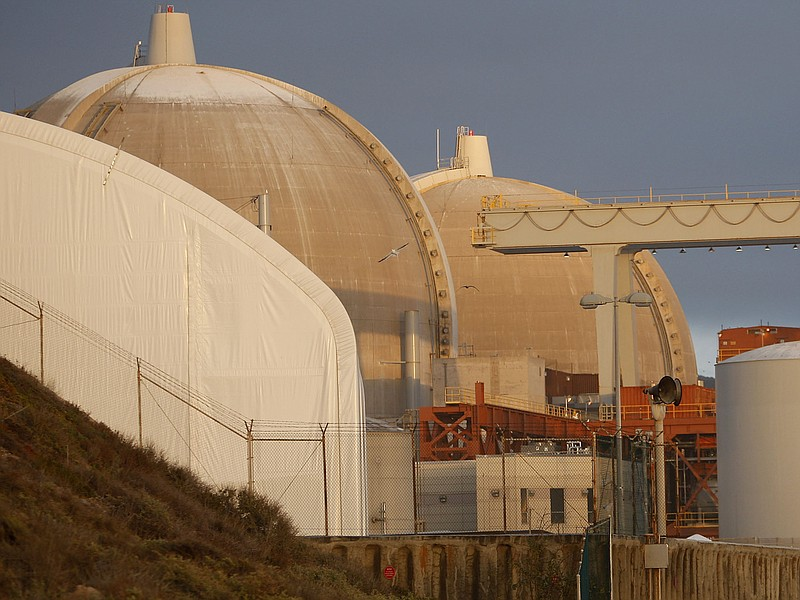 A couple stands near the San Onofre Nuclear Generating Station at San Onofre ...