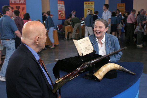 "At ""Antiques Roadshow"" in Providence, Rhode Island, appraiser Bill Guthman hits the bull's eye when he targets a rare Mathewson rifle, powder horn and log book. Guthman attributes the items, handed down through seven generations of the owner's family, to Welcome Mathewson, one of early 19th-century New England's premier gunsmiths. Declaring the item a ""national treasure,"" and one of the most rare and valuable firearms objects ever appraised on ROADSHOW, Guthman values the collection at $100,000 to $120,000."