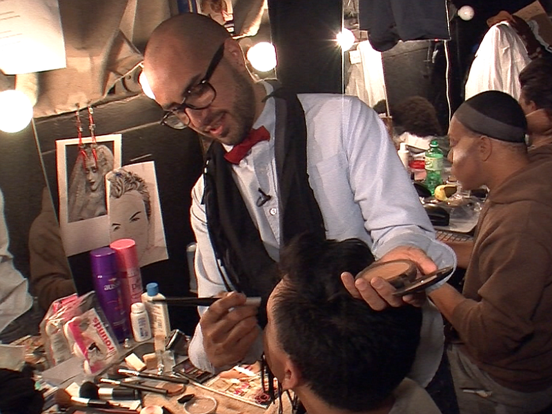 Anthony Diaz helps actor Shaun Tuazon with his make up backstage at Tenth Ave...
