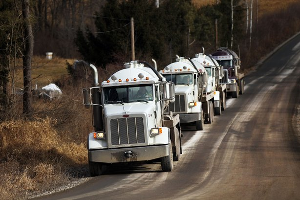 Trucks with the natural gas industry, some of the thousands that pass through the area daily, drive through the countryside on January 18, 2012 in Springville, Pennsylvania.