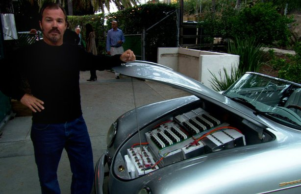 "Greg ""Gadget"" Abbott showing the batteries in his converted car."