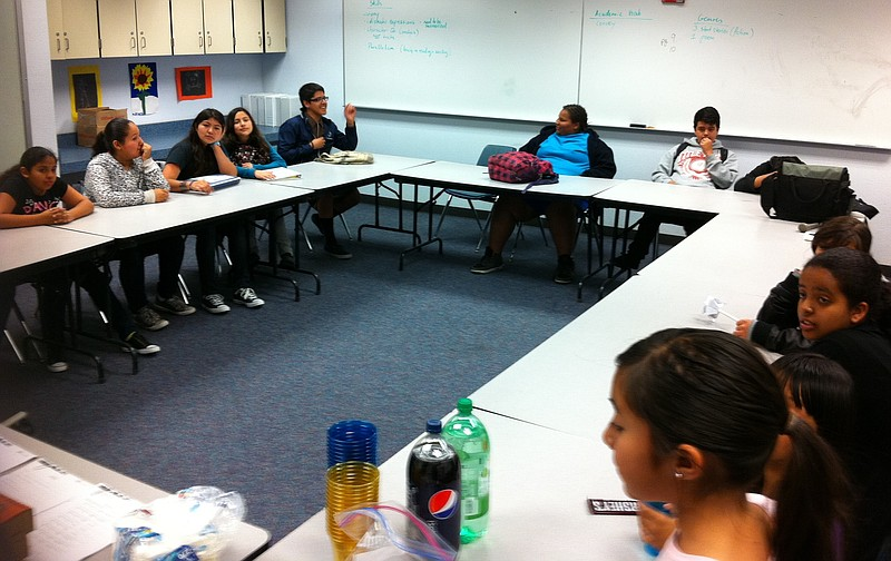 Students attend an AjA Project photography class at Monroe Clark Middle Schoo...
