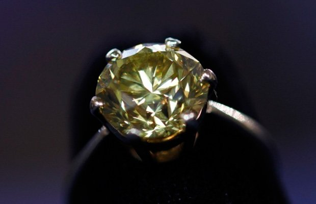 This 3.4 carat fancy intense yellow diamond ring was brought to the Minneapol...
