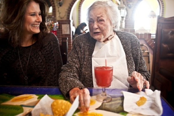 AnnaBelle Bowers, 87, has lunch with granddaughter Kelley Hawkins in Harrisburg, Pa. Kelley and her sister-in-law, LaDonna Martin, jointly care for AnaBelle.
