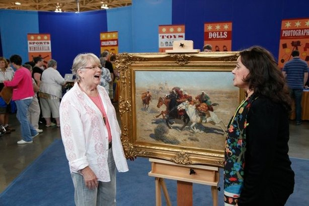 At the ANTIQUES ROADSHOW event in Minneapolis, the owner (left) of this circa 1885 heirloom oil painting by Russian artist Franz Roubaud gasps when appraiser Betty Krulik tells her the hot Russian art market is responsible for the work's value of $100,000.