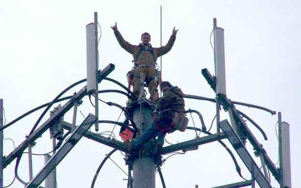 Jay Guilford, top, fell to his death in 2008 while installing cell phone antennas on a tower in Indiana.