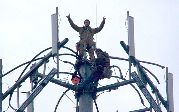 Jay Guilford, top, fell to his death in 2008 while installing cell phone ante...