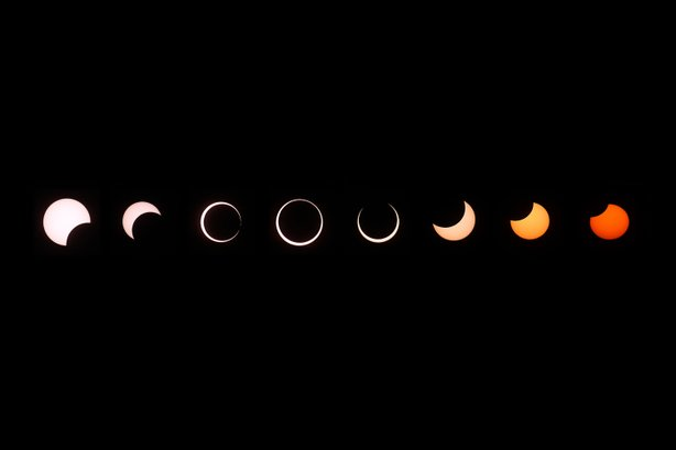 A composite of images of the first annular eclipse seen in the U.S. since 1994 shows several stages, left to right, as the eclipse passes through annularity and the sun changes color as it approaches sunset on May 20, 2012 in Grand Canyon National Park, Arizona.