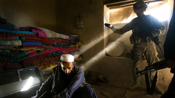 "A scene from ""Hell And Back Again"" with Marines entering a home in Southern Afghanistan."