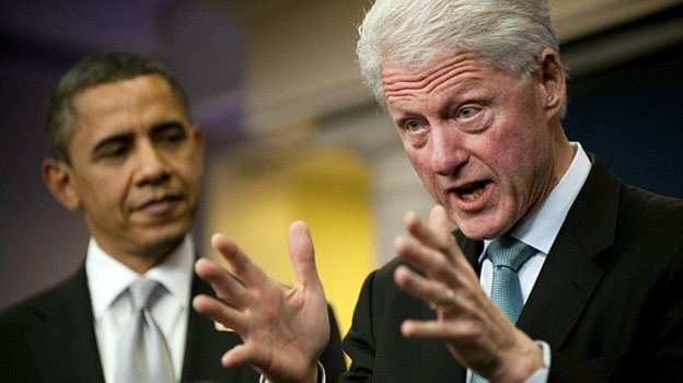 Bill Clinton speaks with President Obama in the White House Briefing Room aft...