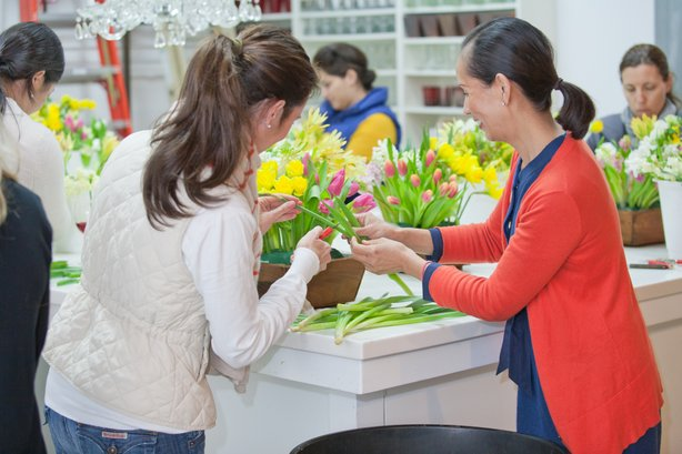 Tam Ashworth (in red) running one of the floral design classes at Isari Flowe...
