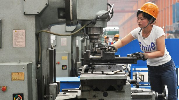 A Chinese worker operates a machine at a factory in Binzhou in northeast Chi...