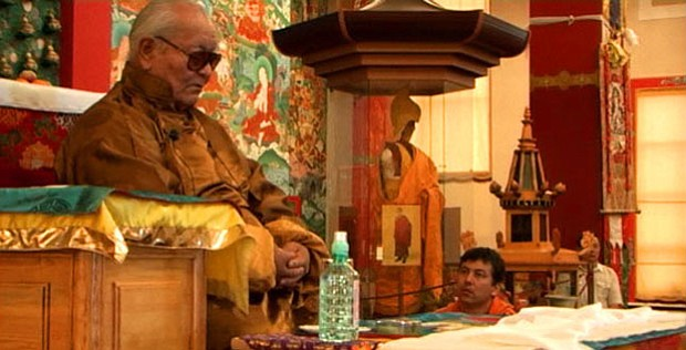 Chögyal Namkhai Norbu teaches while his son, Yeshi, looks on as Rinpoche give...
