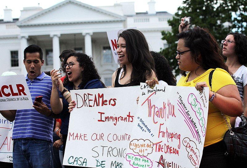Immigration activists gather in front of the White House to celebrate the Oba...